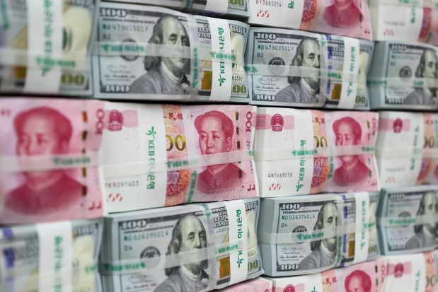 Cina: fuga investitori esteri e boom dei buyback, ma intanto lo Yuan si svaluta e le banche pongono limiti ai prelievi in dollari