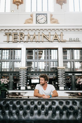 Eric Hinman '02 sitting in Denver's terminal