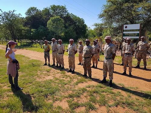 Tara Keir '14 with an anti-poaching unit.