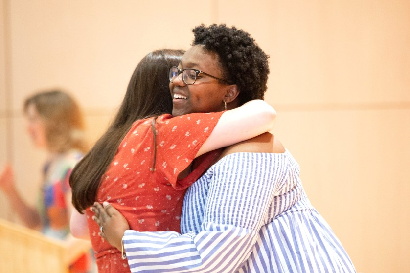 Eunisha Tucker '18 hugs a student at the Lavender Graduation Ceremony in 2019.
