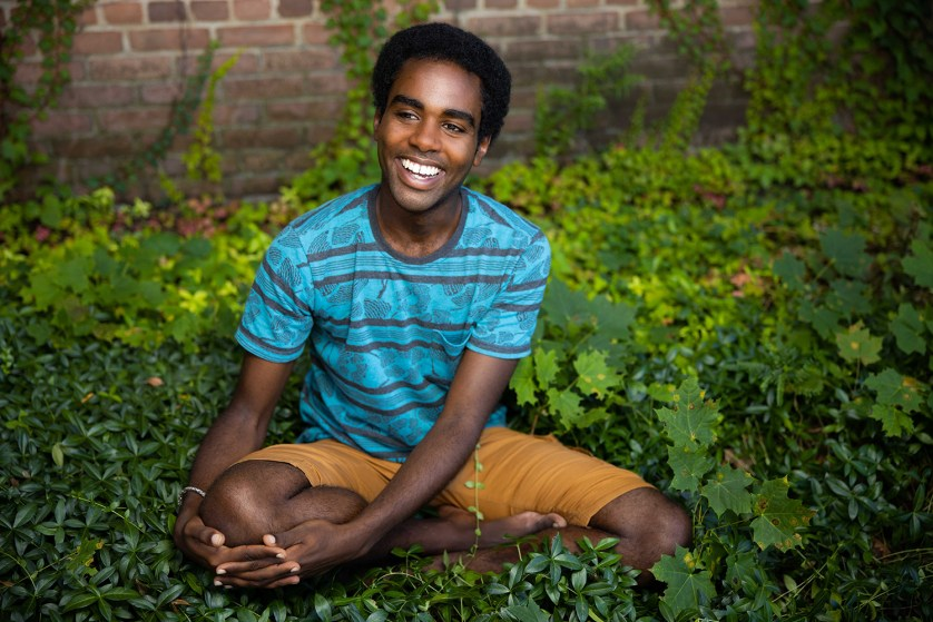 Awab Shawkat '21 has learned about being a good leader. He is sitting in the grass.