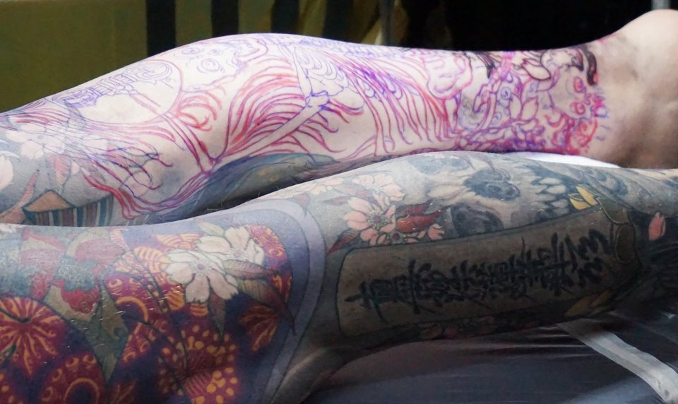 shige yellow blaze leg tattoos