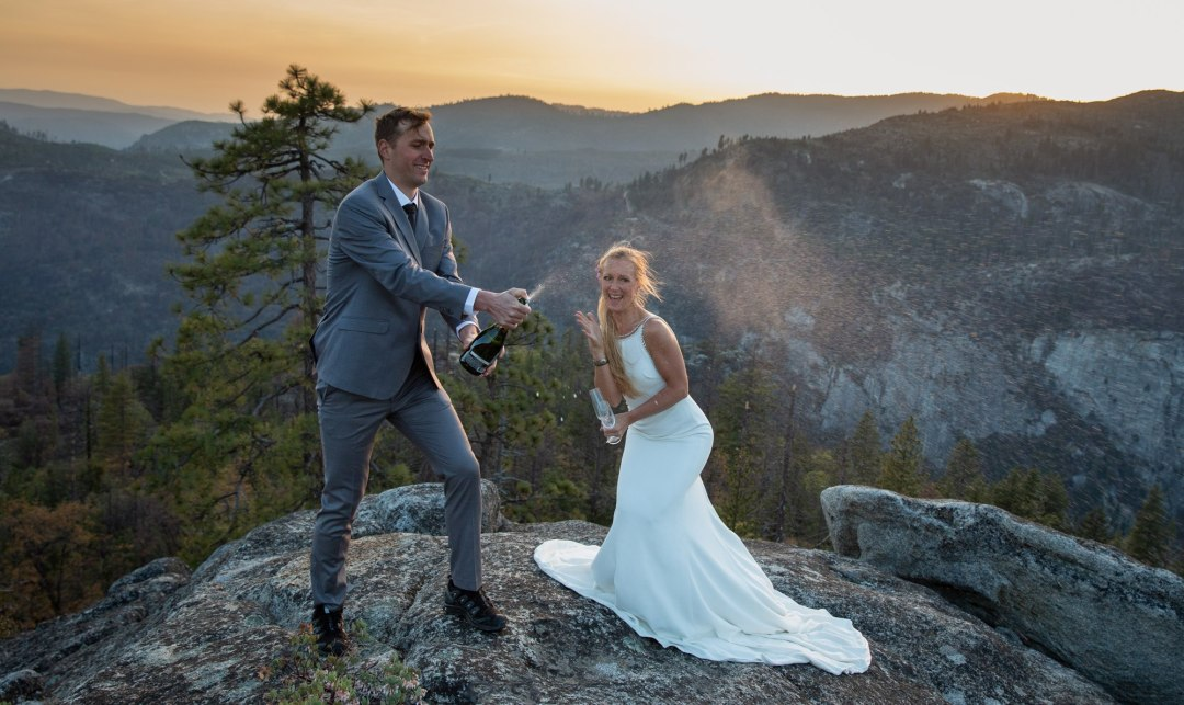 Groom pops the champagne after an incredible sunset adventure elopement.