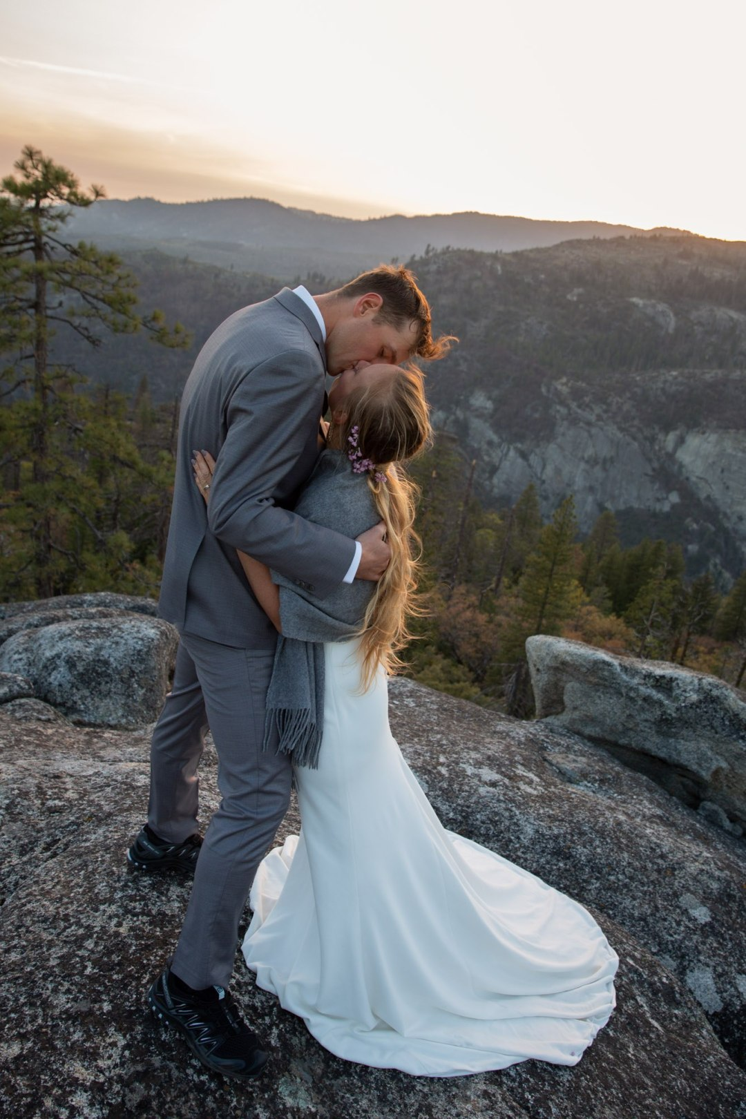 Sneaking kisses during a Yosemite sunset elopement