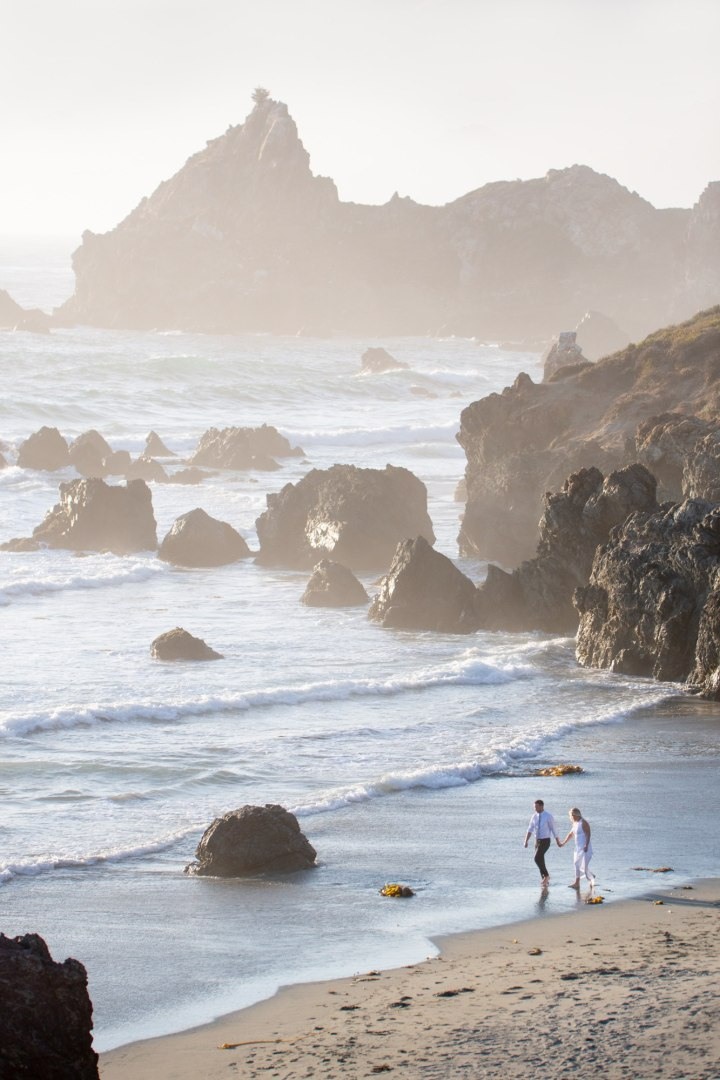 Bride and Groom walking on the beach after their Big Sur beach elopement