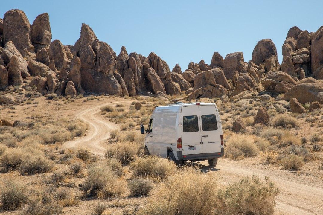 White Sprinter Van drives through the Alabama Hills on the way to an adventure elopement.