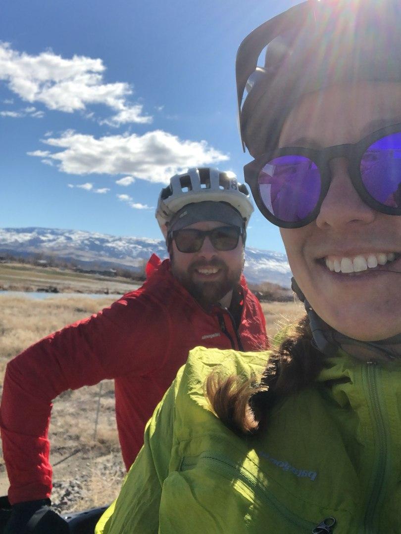 Selfie of Brian & Becky, adventure elopement photographer team, cycling a big loop around Reno.