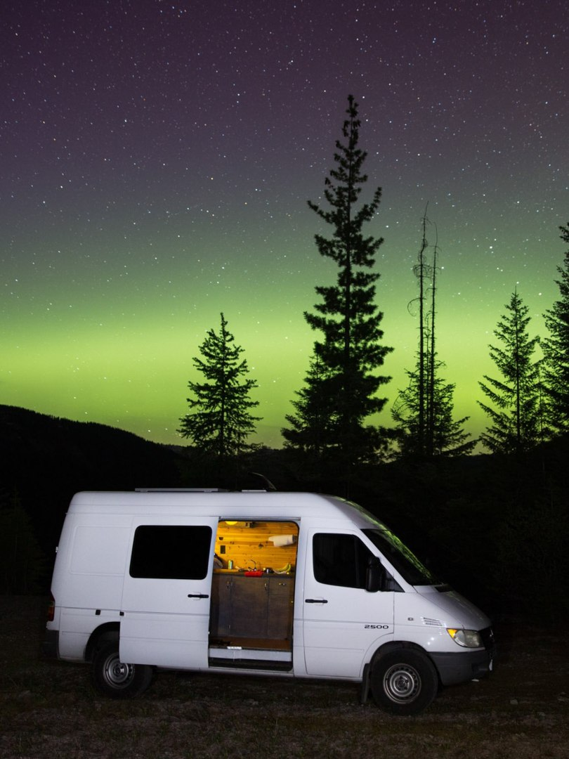 Jorje Blanco poses in the northern lights of Montana.