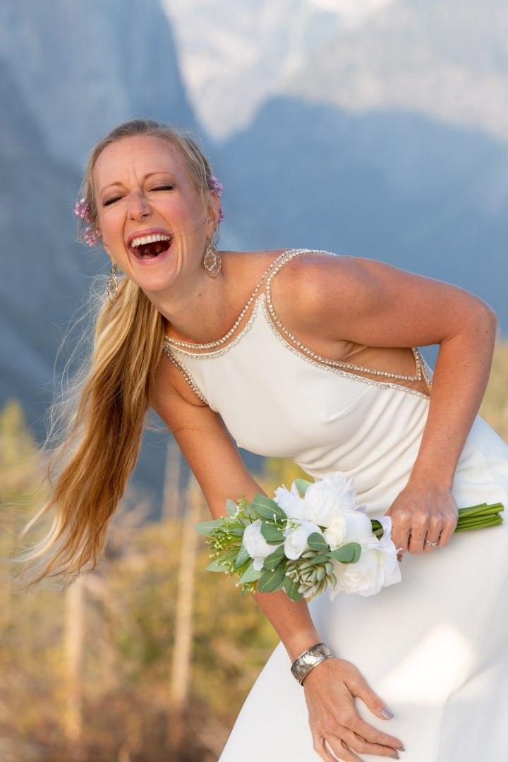 Bride laughing in a Yosemite wedding.
