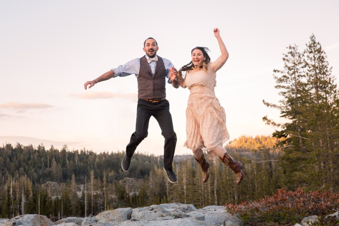 Newly weds jumping for joy just after their Tahoe adventure elopement.