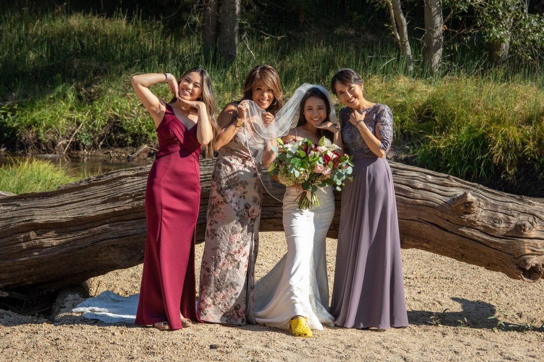 The bridal party (the women of both families) pose for a funny portrait after a Yosemite intimate wedding