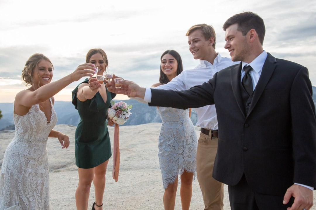 Wedding party toast tequila shots at Taft Point after the Yosemite wedding.