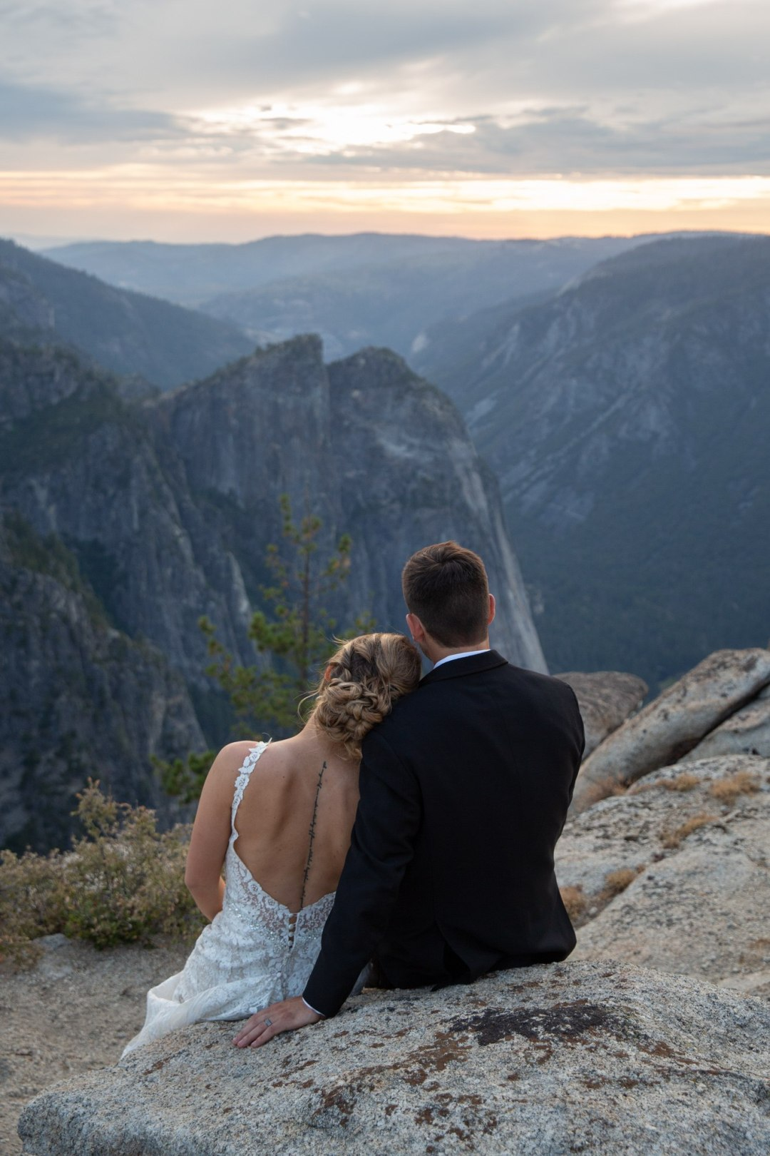 Bride and Groom enjoying the sunset on Taft Point after their Yosemite elopement.