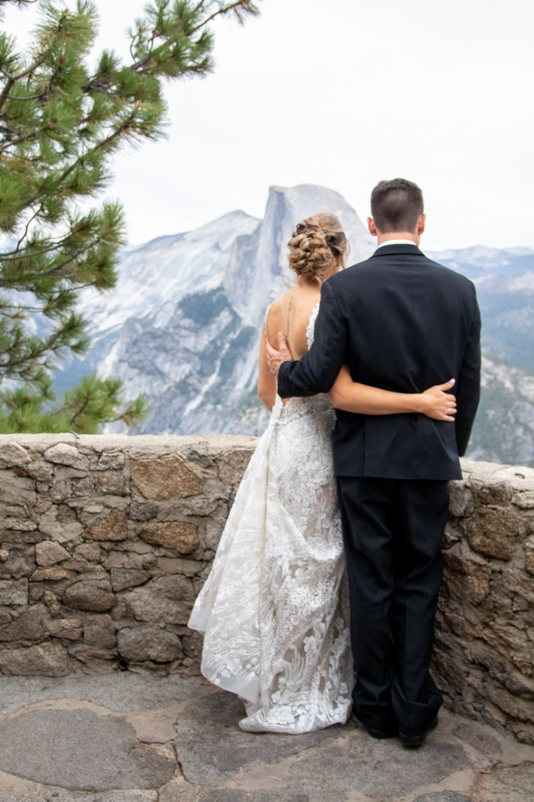 Bride and groom checking out Half Dome before their Yosemite elopement