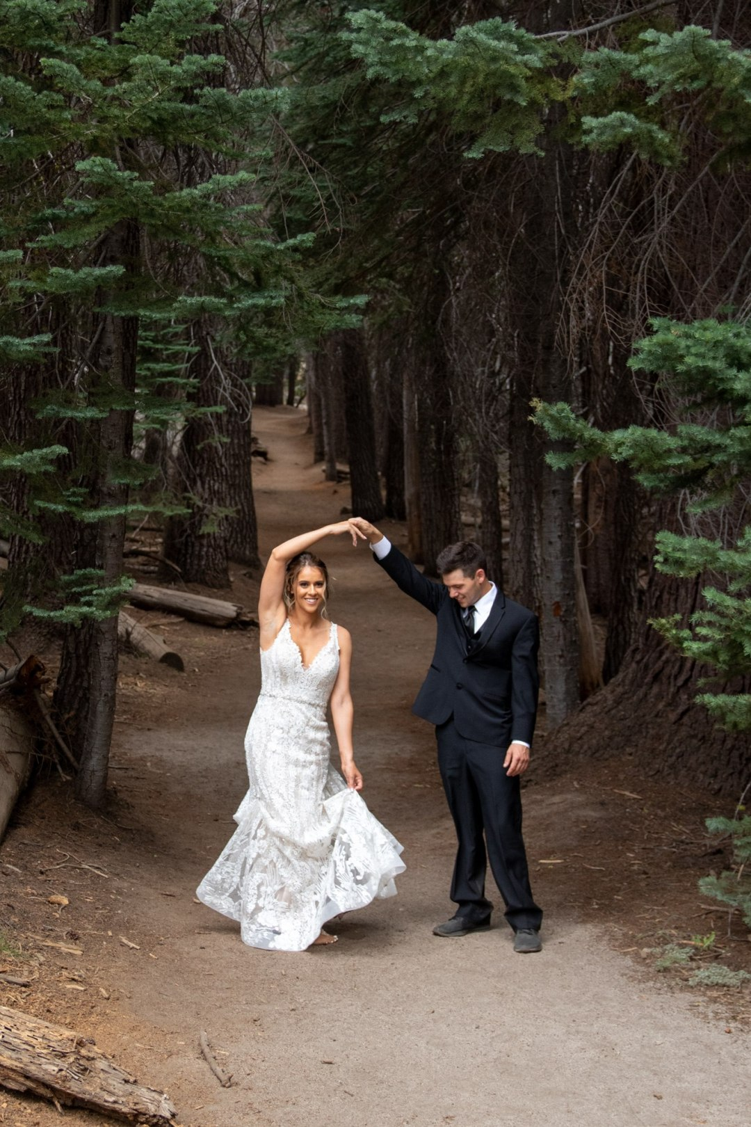 Bride and Groom dancing in the forest on the way to their Taft Point Elopement in Yosemite