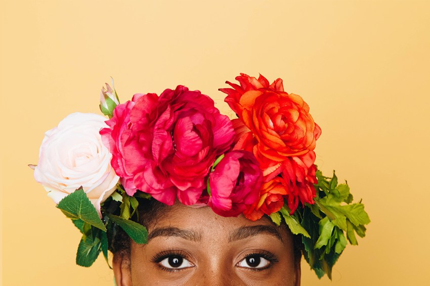 photo of woman wearing a floral crown