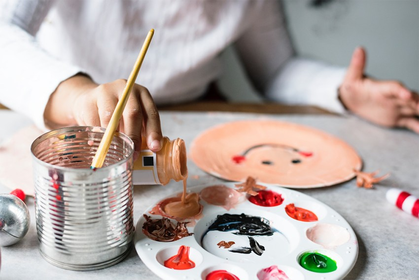 Photo of kids crafting and painting at a table