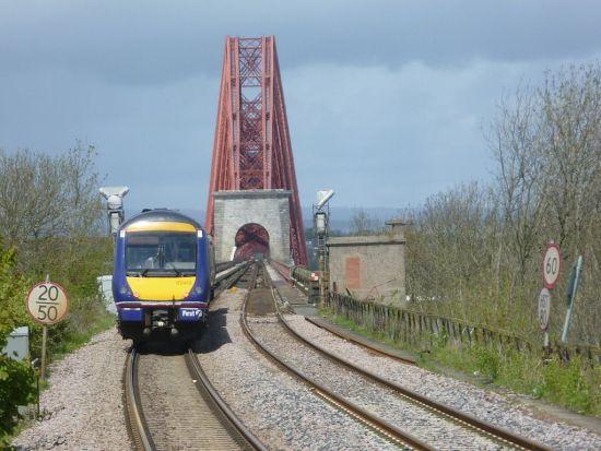 Train approaching Forth Road Bridge: by Kim Traynor