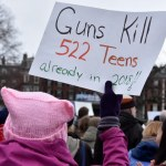 """March for our lives poster reads 'Guns Kill 522 Teens already in 2018"""": image by Anubis Abyss CC BY-SA 2.0"""
