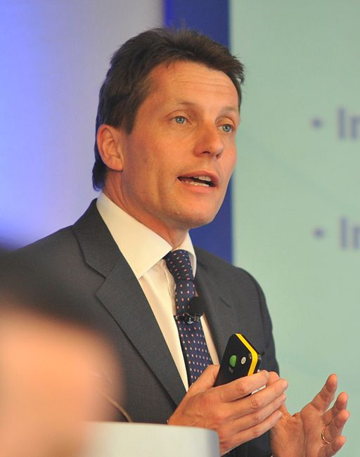 Andy Hornby gesturing with open hands as he speaks at