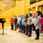 Children singing, eyes firmly fixed on the conductor. Photo Robert McFadzean, courtesy Royal Conservatoire Scotland