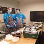 Cyrenians kitchen volunteers in masks and gloves preparing food for delivery