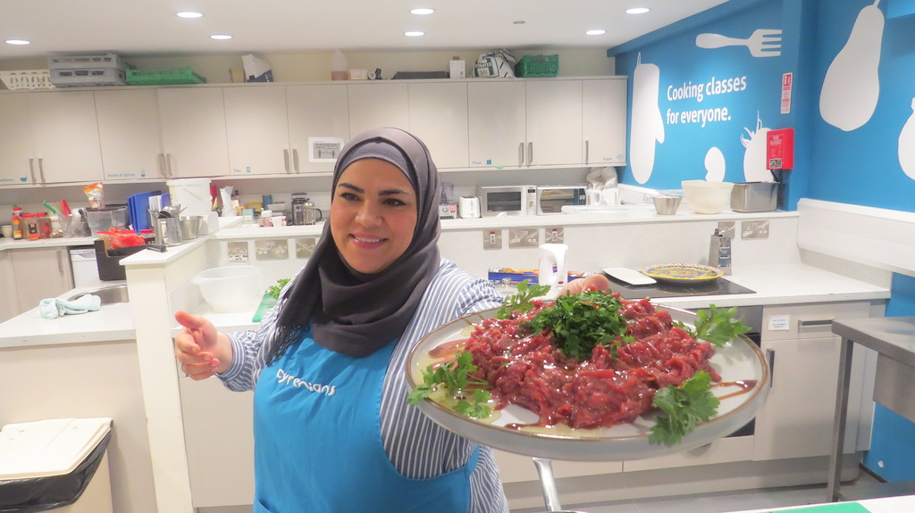 Online Syrian Supper Club: Nouri presents a dish to the camera