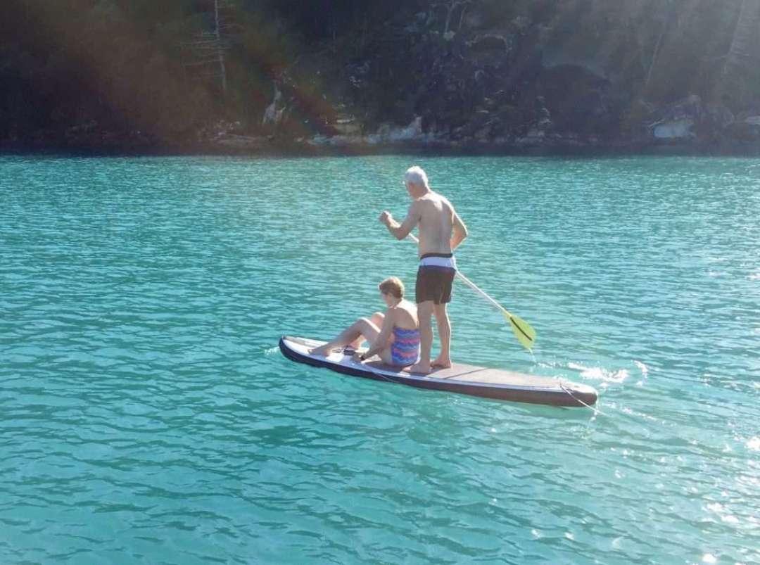 Joe and Mary paddle boarding
