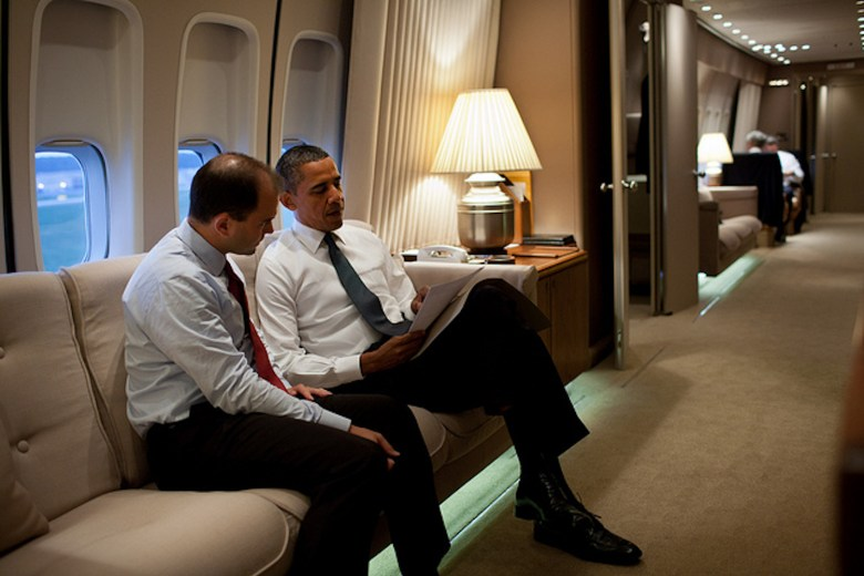Ben Rhodes sits with Barack Obama on Air Force One in 2011.