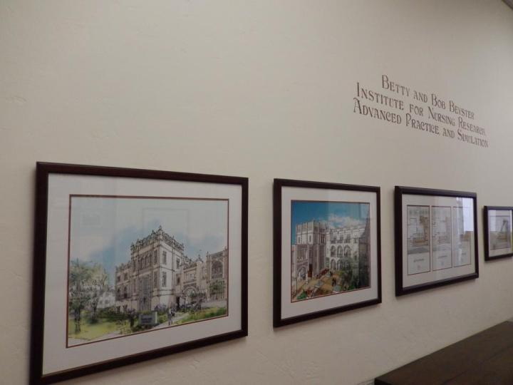 Leigh Ann Pfeiffer design renders and prints are framed throughout adjacent USD building