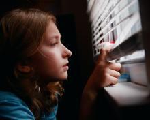 Girl looking at the world through blindsPhoto by Sharon McCutcheon