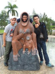 Rudy, Esse and Awang with Orang Utan Props outside of Menara Tun Mustapha
