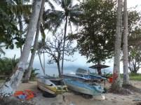 Abandoned boats docking on Kinarut Beach