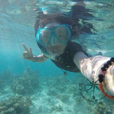 Enjoying Snorkeling around Sibuan Island, Semporna Island Hopping with a Peace Sign