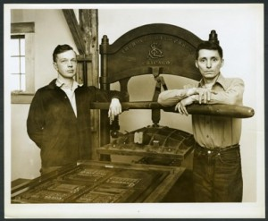 Harry Duncan (left) and Paul Wightman Williams in front of printing press, circa 1955