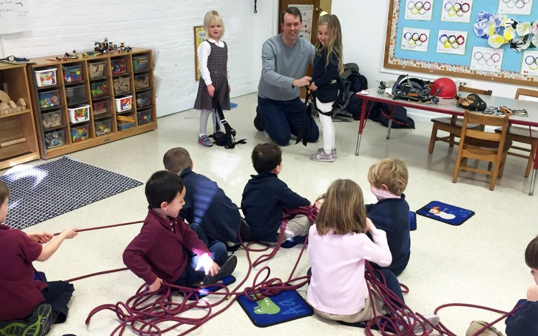 A junior kindergarten parent talks to the class about rock climbing.