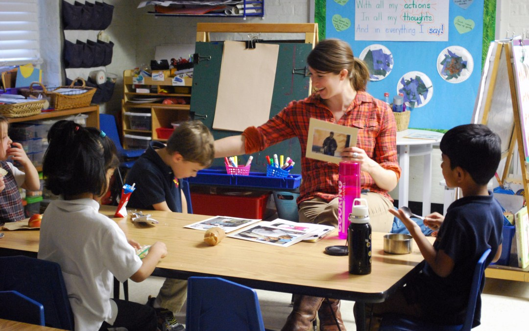 Miss Boese works with a small group of students during project week.