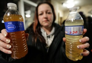 Image from associated press.com  A woman from Flint with water samples from her home.