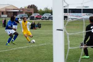 Photos by: Alex Regish Staff Photographer Sophomore Mid-Fielder(#11) Davide Di Poce beats a Lakeland defender to take a shot on the Lakeland Goal tender on October 4th at Schoolcraft College.