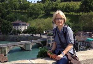 IMAGE COURTEST OF ANITA SÜESS Professor Anita Süess rests on bridge in the old town of Bern in her home country, Switzerland.