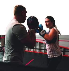 Boxer Jordan Newton strikes hard against trainer Devin Skrmbellos at Title Boxing in Canton.