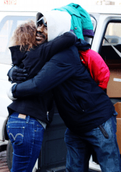 After dining at the soup kitchen, an embrace is shared.