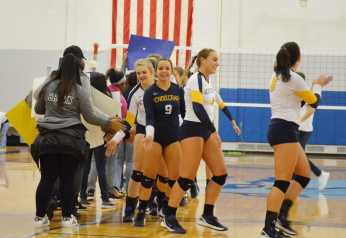 The team shakes hands with members of the Monarchs after playing a close third set and winning the game.