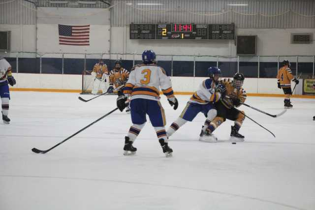 (Left) Defenseman Andrew Nowak, (Center) Center Andrew Lindsay, and (right) defenseman Austin McKibbin battle the Lakers on Nov. 12 and help win the game 8-5.