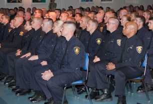Police Academy recruits listening to a speaker.