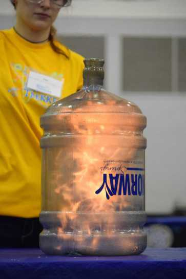 The Whoosh Bottle showed kids that if you coat the inside of a bottle in oil and drop a match in, it produces a flame and a large noise.