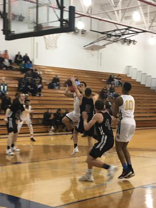 Davante Carter, #23, fights for the team.