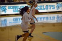 Sharon Woodard, #5, and Megan Sandiha, #24, working together to cross the court.
