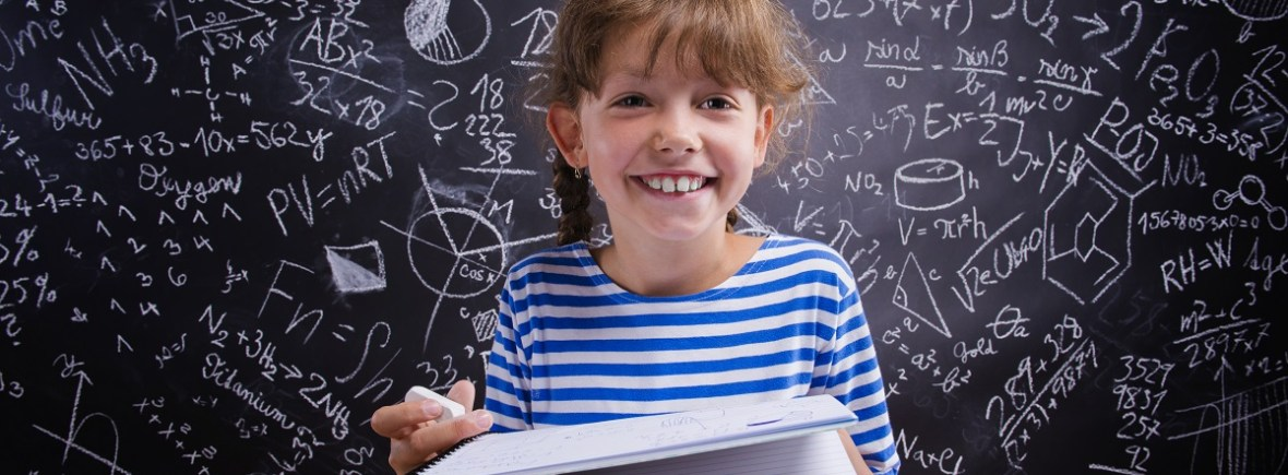 little girl in front of big blackboard