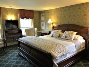 The Hearth Suite - classic décor with a beautiful king size sleigh bed and wood burning fireplace.